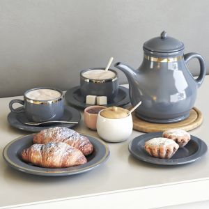 Tea Set With Croissant And Muffin